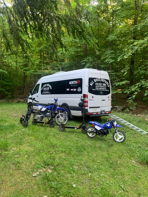 ABR van in forest with bikes